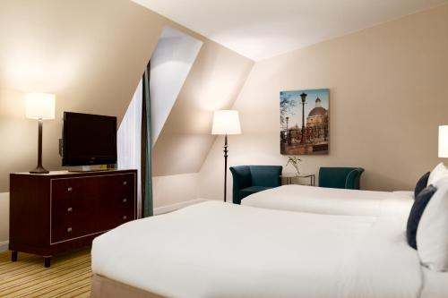 A bed or beds in a room at Renaissance Amsterdam Hotel
