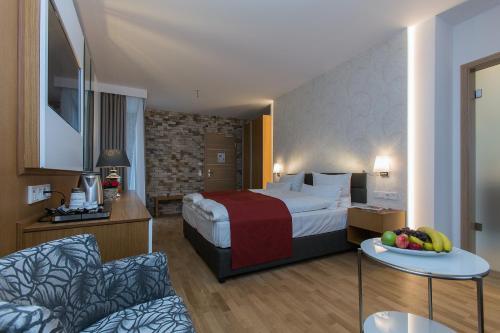 Ein Bett oder Betten in einem Zimmer der Unterkunft Hotel am Schrannenplatz