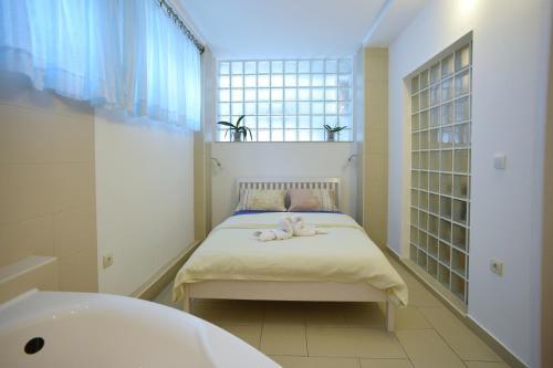 Кровать или кровати в номере Apartment Hermes