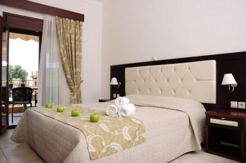 A bed or beds in a room at Allea Hotel and Apartments