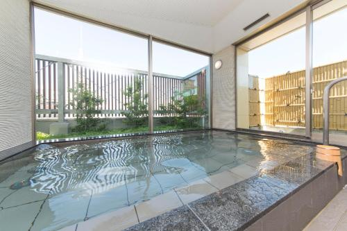 The swimming pool at or near Sanco Inn Nagoya Nishiki