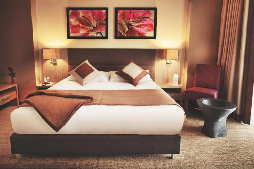 A bed or beds in a room at Mirotel Resort and Spa