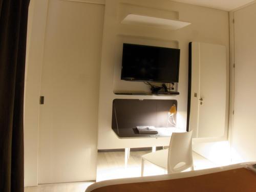A television and/or entertainment center at La Maison de Léa
