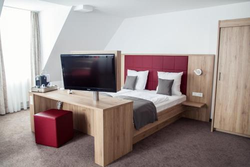 A television and/or entertainment centre at Hotel Specht