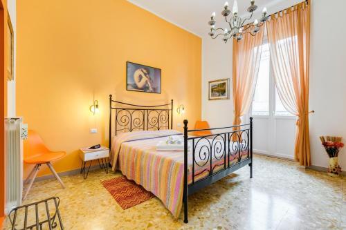Letto o letti in una camera di 2 Passi Al Colosseo B&B