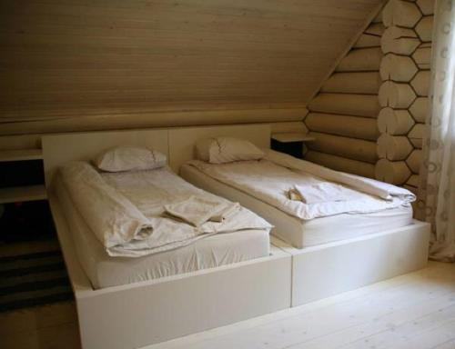A bed or beds in a room at Kompleks otdyha Volzhanka