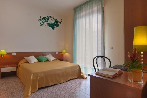 Кровать или кровати в номере Diva Hotel