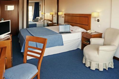 Uma cama ou camas num quarto em Agua Hotels Nelas Parq