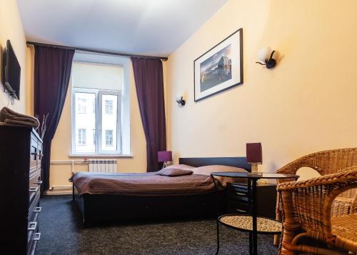Кровать или кровати в номере Мини Отель на Невском 136