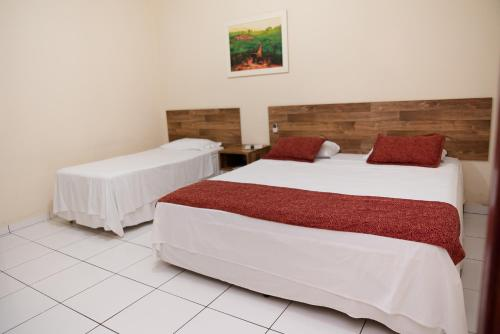 A bed or beds in a room at Hotel Marrocos