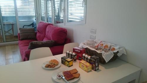 A seating area at San Siro Apartment