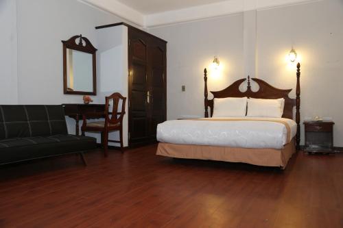 Cama o camas de una habitación en Alcalá Apart Hotel