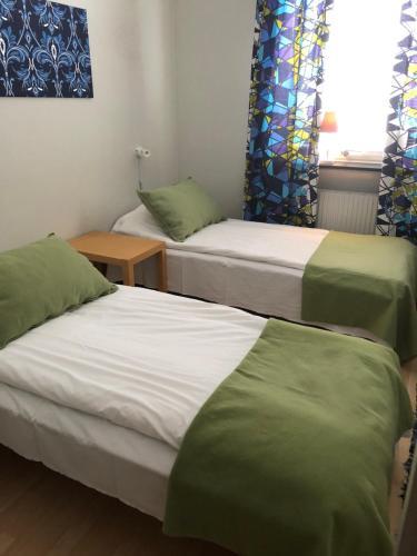 Säng eller sängar i ett rum på Nätra Motell