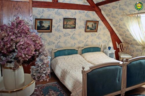 Un ou plusieurs lits dans un hébergement de l'établissement La ferme de la vallée