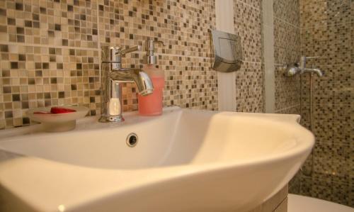Ванная комната в Lakki Village
