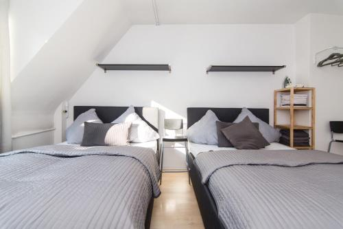 A bed or beds in a room at Altstadt Kapuzinergasse