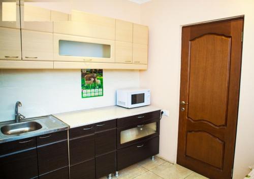 Кухня или мини-кухня в Guest House Veronika