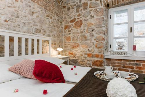 A bed or beds in a room at Apartments Santa Lucia Exclusive