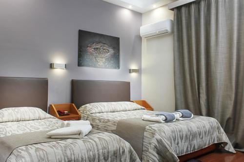 Ένα ή περισσότερα κρεβάτια σε δωμάτιο στο Hotel Lithaion