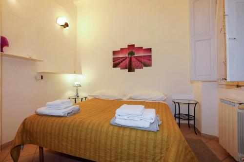 A bed or beds in a room at La Corte di Piero