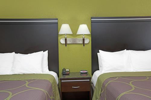 A bed or beds in a room at Super 8 by Wyndham Inglewood/LAX/LA Airport