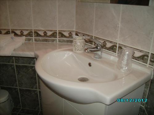Salle de bains dans l'établissement Terroir et Tradition A La Ducasse