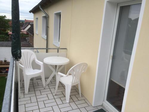 Ein Balkon oder eine Terrasse in der Unterkunft Abelia Gästehäuser