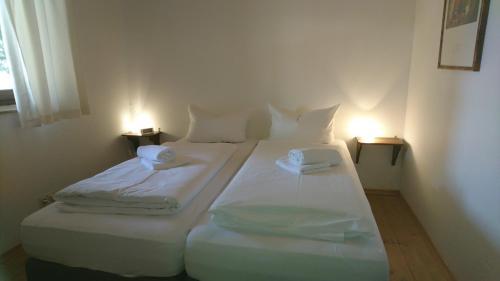 Een bed of bedden in een kamer bij Pension Bergblick