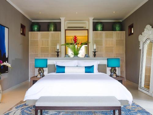 Кровать или кровати в номере The Arsana Estate