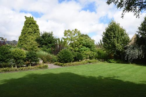 "A garden outside Cotswold House Hotel and Spa - ""A Bespoke Hotel"""
