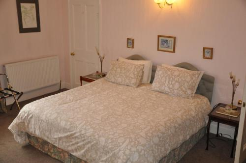 A bed or beds in a room at Heath House
