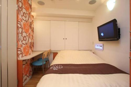 A bed or beds in a room at Hotel Bianca Due (Adult Only)