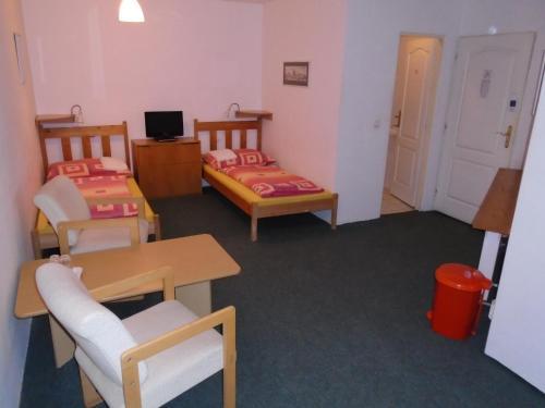 Кровать или кровати в номере Pension Dobroucky