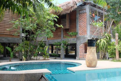The swimming pool at or near Panji Panji Tropical Wooden Home