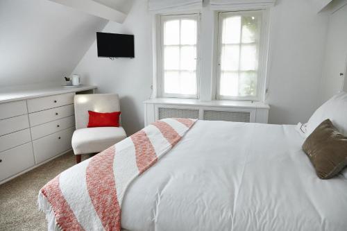 Un ou plusieurs lits dans un hébergement de l'établissement Guest house La Maison Chantecler