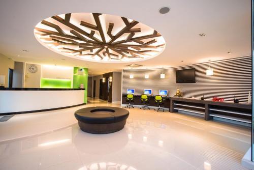 The lobby or reception area at Napatra Hotel