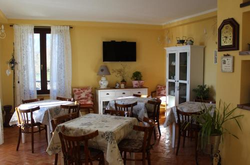 A restaurant or other place to eat at Le Fiorini