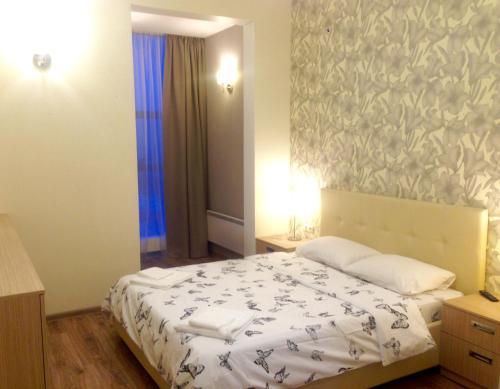 Кровать или кровати в номере Apart Hotel Pulkovo Meridian
