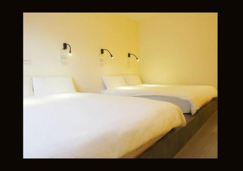 A bed or beds in a room at Ximen Corner Hostel