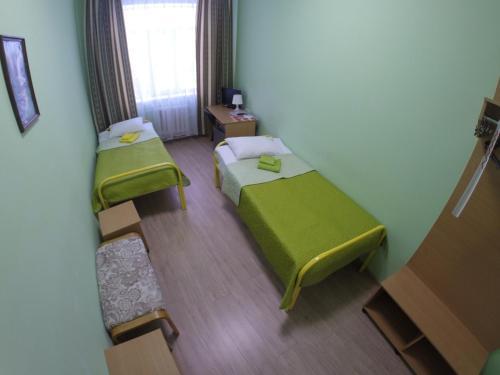 Кровать или кровати в номере Отель Большой Урал на Малышева