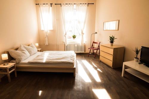 Ein Bett oder Betten in einem Zimmer der Unterkunft Re4Hostel