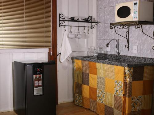 A kitchen or kitchenette at Cabana da Imperatriz