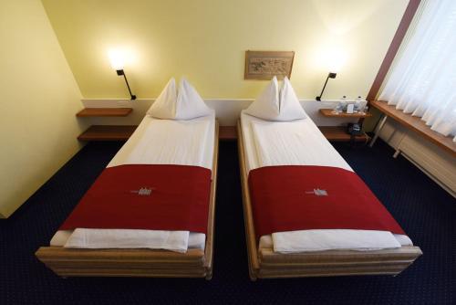 Ein Bett oder Betten in einem Zimmer der Unterkunft Hotel Dufour