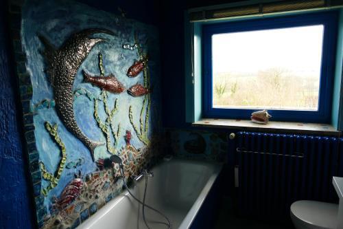 Salle de bains dans l'établissement Un Petit Coin De Paradis