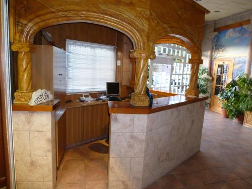 The lobby or reception area at Hotel Limas