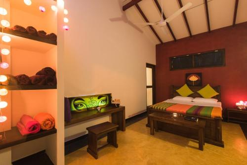 A bed or beds in a room at Your Dream Home - Mirissa