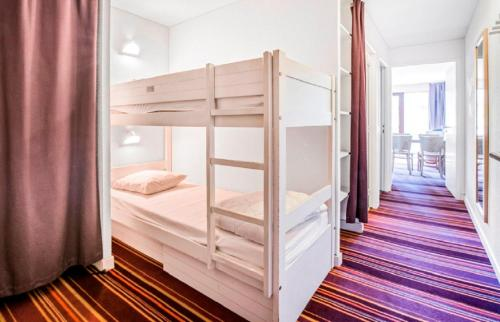 A bunk bed or bunk beds in a room at Maeva Particuliers Residence La Daille