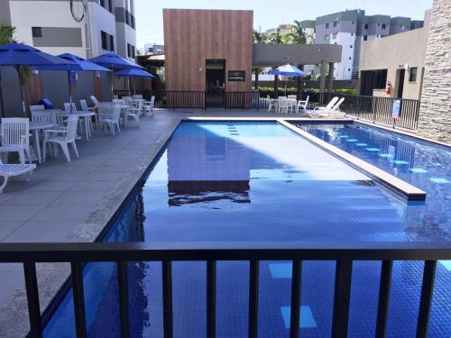 The swimming pool at or near Apto próximo à Fac. Pio X