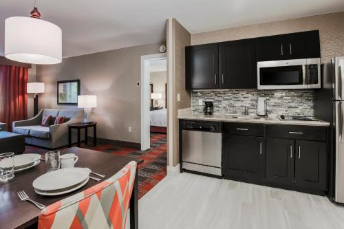 A kitchen or kitchenette at Homewood Suites by Hilton Long Island-Melville