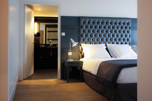 Кровать или кровати в номере Newhotel Opéra